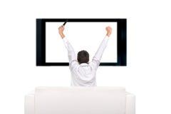 Pessoa e aparelho de televisão Fotografia de Stock Royalty Free