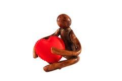 A pessoa e o coração do símbolo Foto de Stock Royalty Free