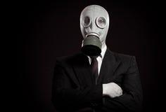 Pessoa em uma máscara de gás Imagens de Stock