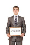 Pessoa nova feliz do negócio que guarda o sinal do vencedor imagem de stock