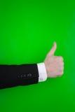 A pessoa que faz os polegares levanta o sinal Fotos de Stock