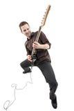 Pessoa que joga uma guitarra fotografia de stock