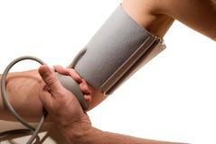 Pessoa que toma a pressão sanguínea Imagem de Stock Royalty Free