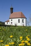 Pest chapel in flower meadow Royalty Free Stock Image