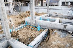 Pest control pipe system install at new house construction. Foundation for termite protection Royalty Free Stock Images