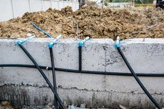 Pest control pipe system install at new house construction. Foundation for termite protection Stock Photos