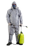 Pest Control Worker. A pest control worker wearing a mask, hood, protective suit and dual air filters holding a hose to help exterminate rats and other vermin Stock Image
