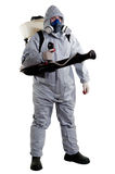 Pest Control Worker. A pest control worker wearing a mask, hood, protective suit and dual air filters holding a hose to help exterminate rats and other vermin Royalty Free Stock Images