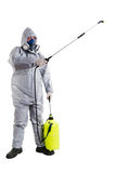 Pest Control Worker. A pest control worker wearing a mask, hood, protective suit and dual air filters holding a hose to help exterminate rats and other vermin Royalty Free Stock Photography