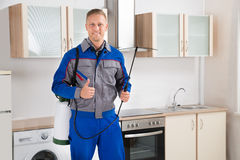 Pest Control Worker With Insecticide Sprayer Royalty Free Stock Photos