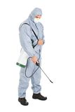 Pest control worker with pesticides sprayer. Pest Control Worker In Protective Workwear With Pesticides Sprayer Over White Background Royalty Free Stock Photos