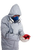 PEST CONTROL WORKER. A pest control worker wearing a mask, hood, protective suit and dual air filters holding Royalty Free Stock Photos