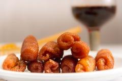 Pestiños with honey anis and oporto typical gastronomy of andalucia. Fried pestiños with honey anis and port typical of Spanish gastronomy stock photos