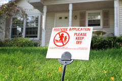 Pesticide Application. Pesticide warning sign on the lawn in front of a house Stock Images
