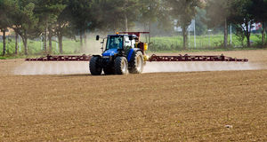 Pesticides. Agricultural tractor during weed control with pesticides Stock Images