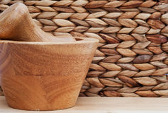 Pestle and mortar with basketweave background Royalty Free Stock Photos
