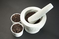 Pestle and Mortar with Black Pepper Royalty Free Stock Images
