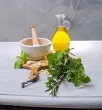 Pestle mortar fresh herbs. And olive oil Stock Photo