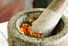 A pestle and mortar and ingredient cooking Stock Photography