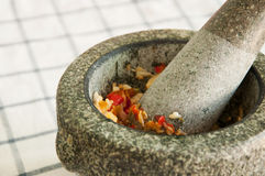 A pestle and mortar and ingredient cooking Royalty Free Stock Images