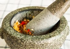 A pestle and mortar and ingredient cooking Royalty Free Stock Image
