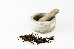 Pestle and Mortar with peppercorns Stock Photo