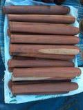 Pestle pounding chilies Stock Photo