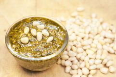 Pesto and cedar nuts on the wooden background Stock Photos