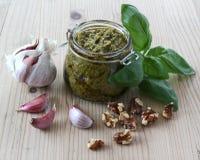 Pesto con ajo, las nueces y la albahaca Imágenes de archivo libres de regalías