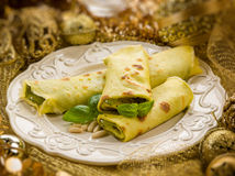 Pesto crepes over golden christmas Stock Photo