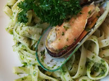 Pesto. Fettuchini pesto seafood on white plate at the restaurant stock images