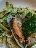 Pesto. Fettuchini pesto seafood on white plate at the restaurant Royalty Free Stock Image