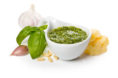 Pesto Genovese in a gravy boat and ingredients. Close-up Stock Photography