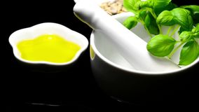 Pesto ingredients, basil leaves, olive oil and sunflower seeds stock footage