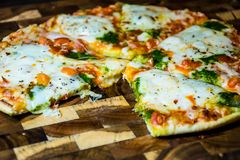 Eaten Slice from a Perfect Delicious Hot Oven Home Made Pizza Royalty Free Stock Photography