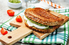 Pesto Mozzarella tomatoes grilled rye sandwich Stock Photos
