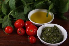 Pesto and Olive oil. Some herb leaves with olive oil Stock Photo