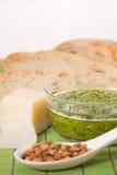 Pesto, parmesan,pine nuts and bread Royalty Free Stock Image