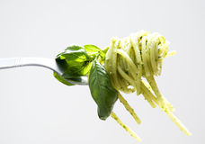 Pesto pasta. Fork with pesto pasta and leaf of basil Stock Images