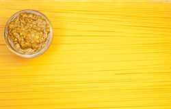 Pesto on pasta background Royalty Free Stock Images
