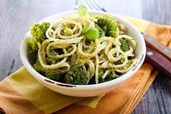 Pesto pasta with broccoli. In a bowl Stock Photos