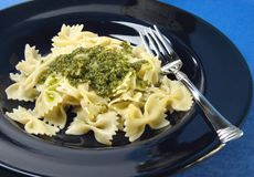 Pesto pasta dinner. Farfalle with pesto royalty free stock photos