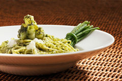Pesto pasta is an Italian staple food Stock Photo