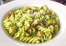 Pesto Pasta. Pasta pesto with tomatoes and mushrooms Royalty Free Stock Image