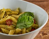 Pesto Pasta in a White Bowl royalty free stock photography