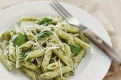 Pesto Pasta. Pasta with Pesto on White Plate with Fork Stock Photography