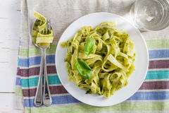 Pesto pasta on white plate Stock Images