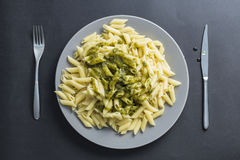 Pesto penne pasta dish on a black background Royalty Free Stock Image