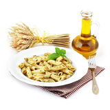 Pesto plate. Pesto plate with olive bottle on white background Stock Photo