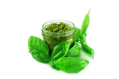 Pesto sauce and basil leaves Royalty Free Stock Images
